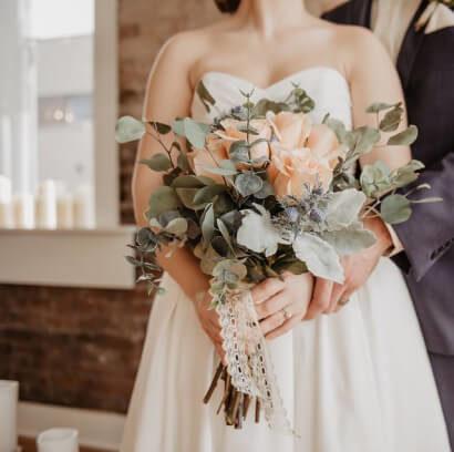 Bride holding flowers