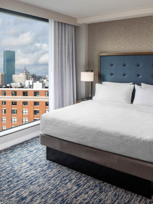 Queen bed with a view in a suite