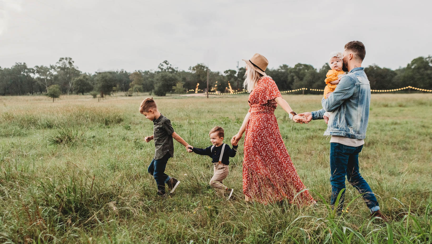 Family with kids walking in a field